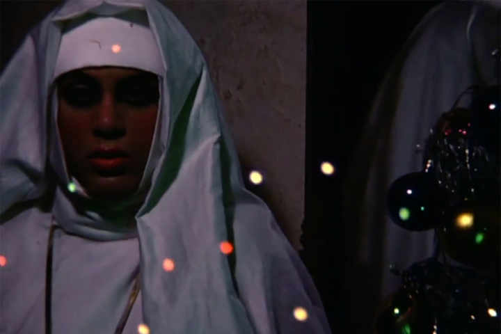 "Still from Untitled (from ""Gems and Super 8 Rushes"" featuring Mario Montez as a nun)"