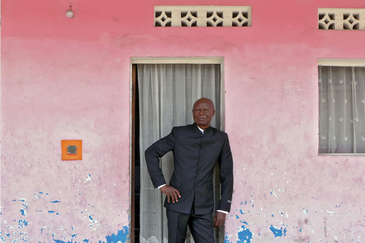 Bodys Isek Kingelez outside his home in Kinshasa, 2014